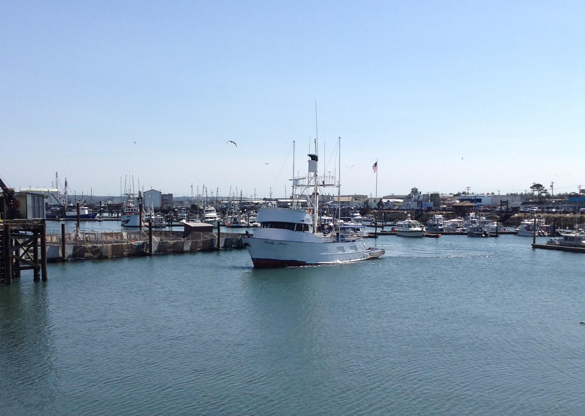 Commercial Boat heading to unload fish at docks-Westport Washington